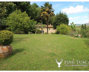 Farmhouse with land and outbuildings for sale in Volterra Tuscany